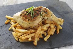 Grilled  chicken leg French fries and vegetables Stock Photo