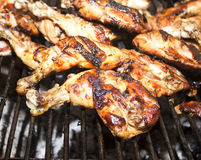 Grilled chicken Leg on the grill Royalty Free Stock Photos
