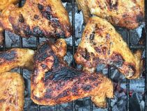 Grilled chicken Leg on the grill royalty free stock image