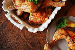 Grilled chicken leg with potato for garnish. Top view. Wooden background. Royalty Free Stock Images