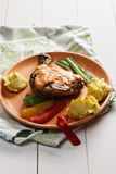 Grilled chicken leg with potatoes Royalty Free Stock Photo