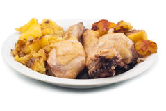 Grilled chicken leg and potatoes. On the white plate Stock Images