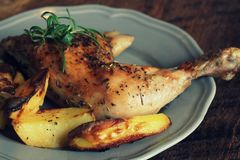 Grilled Chicken Leg, Quarter With Potato For Garnish. Top View. Wooden Background Royalty Free Stock Photography