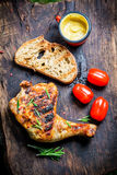 Grilled chicken leg with rosemary and pepper Stock Images