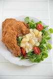 Grilled chicken leg with salad Royalty Free Stock Photos