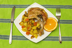 Grilled chicken leg with slice orange Royalty Free Stock Photo