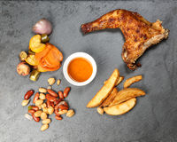 Grilled Chicken Leg stone slate Stock Images