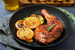 Grilled chicken leg. And vegetables in frying pan Stock Photo