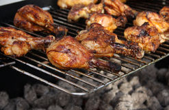 Yummy chicken legs. Grilled chicken legs and hot coal pieces Royalty Free Stock Image