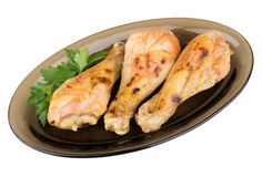 Grilled chicken legs in black dish isolated on white Royalty Free Stock Images