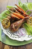 Grilled chicken legs and carrots Stock Photo