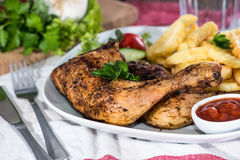 Grilled Chicken Legs with Chips Royalty Free Stock Image