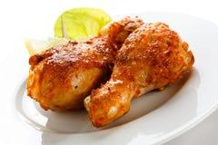 Grilled chicken legs. Grilled chicken drumsticks on white background royalty free stock photos