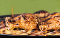 Grilled chicken legs on fire Royalty Free Stock Photography