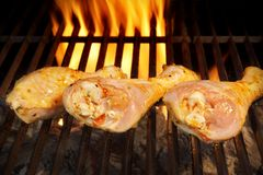 Grilled chicken legs on the flaming grill Stock Photography