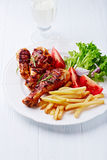 Grilled Chicken Legs with French Fries and Salad Royalty Free Stock Image