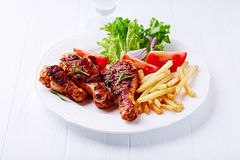Grilled Chicken Legs with French Fries and Salad Royalty Free Stock Photography