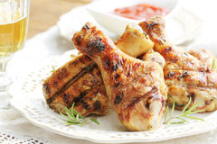 Grilled chicken legs with lemon Stock Image