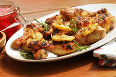 Grilled chicken legs with lemon Royalty Free Stock Photography