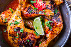 Grilled chicken legs, lettuce and cherry tomatoes limet olives. Traditional cuisine. Mediterranean cuisine Royalty Free Stock Photo