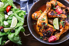 Grilled chicken legs, lettuce and cherry tomatoes limet olives. Traditional cuisine. Mediterranean cuisine Royalty Free Stock Photography