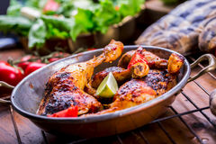 Grilled chicken legs, lettuce and cherry tomatoes limet olives. Traditional cuisine. Mediterranean cuisine Stock Images