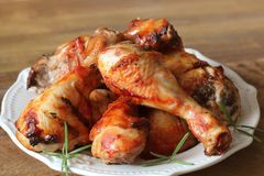 Grilled Chicken Legs On White Plate .Rustic Dinner Background Stock Photography