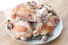 Grilled chicken legs on plate Stock Photography