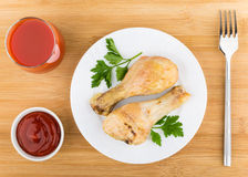 Grilled chicken legs in plate, tomato juice and sauce Royalty Free Stock Photography