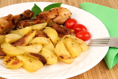 Grilled chicken legs with potato wedges Stock Photography