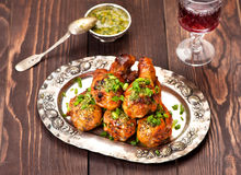 Grilled chicken legs with spicy hot sauce Stock Images