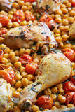 Grilled chicken legs with turkish peas. And tomatoes Royalty Free Stock Image