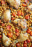 Grilled chicken legs with turkish peas. And tomatoes Stock Image