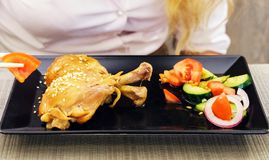 grilled chicken legs and vegetable salad stock images