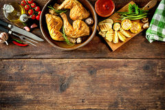 Grilled chicken legs. With vegetables royalty free stock images