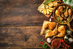 Grilled chicken legs. With vegetables stock image