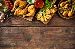 Grilled chicken legs. With vegetables stock photography