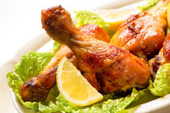 Grilled chicken legs. And vegetables royalty free stock image