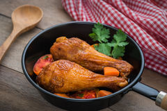 Grilled chicken legs and vegetables in pan Stock Photography