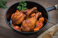 Grilled chicken legs and vegetables in pan Stock Image