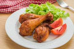 Grilled chicken legs and vegetables on plate Royalty Free Stock Photography