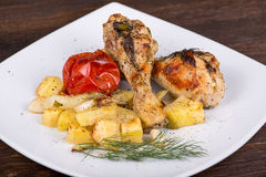 Grilled chicken legs with vegetables Royalty Free Stock Image