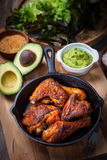 Grilled chicken legs and wings with guacamole Royalty Free Stock Photos