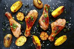 Grilled Chicken Legs With Potato Slices.Top View. Stock Photo
