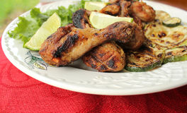 Grilled Chicken Legs With Vegetables Stock Image