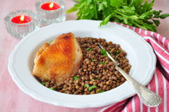 Grilled chicken with a lentil, olive oil and parsley Stock Photo