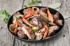 Grilled chicken liver in frying pan Stock Photography