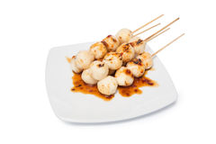 Grilled chicken meat ball with sweet spicy sauce isolated on whi. Grilled chicken meat ball on plate with sweet spicy sauce isolated on white background Royalty Free Stock Photo