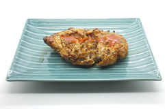 Grilled chicken meat on dish Stock Image