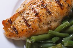 Grilled chicken meat with green beans. view from above Royalty Free Stock Images